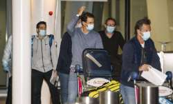 Spain's Rafael Nadal, center, arrives at Adelaide Airport