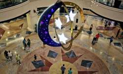 People walk inside a shopping mall with Ramadan decorations as they prepare for the holy month of Ra