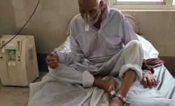 In picture, 90-year-old prisoner chained during treatment