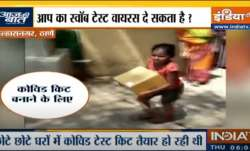 Women and children in the slum of Ulhasnagar found packing