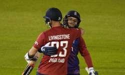England's Sam Curran, right, hugs teammate England's Liam