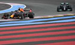 Red Bull driver Max Verstappen, left, leads next to