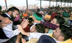 Lakha Sidhana (L), meets his supporters as he arrives to