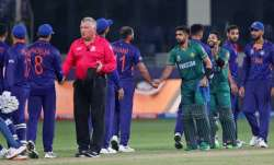 Indian, in blue, and Pakistan's cricketers greet each other at the end of the Cricket Twenty20 World