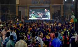 Cricket fans watch the World Cup T20 match of India and