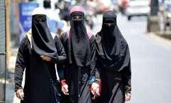 woman forced to take off burkha