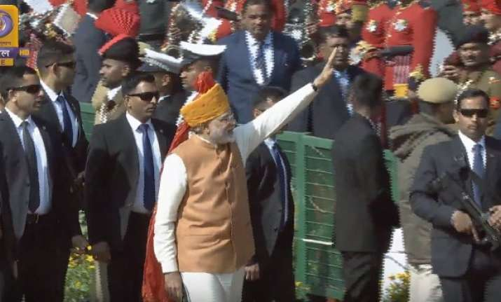 PM Modi grees children at Rajpth as Republic Day parade