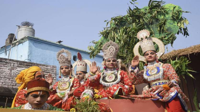 A tableau depicting Lord Ram passes through a street on the eve of Diwali festival, in Ayodhya