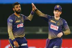 Varun Chakravarthy and Eoin Morgan