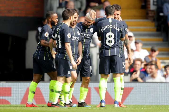 Manchester City top league after thrashing Fulham 2-0