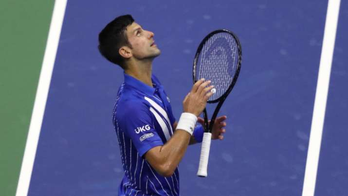 Right on time: Novak Djokovic questions Open clock on way to 24-0