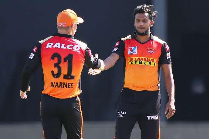 T Natarajan and David Warner.