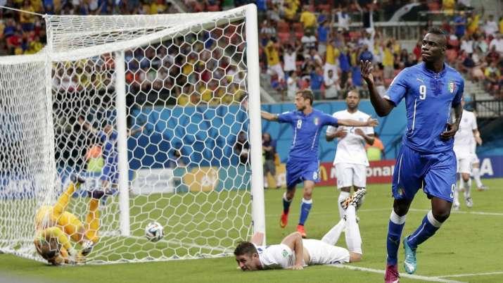 Italy's Mario Balotelli celebrates after scoring past England's goalkeeper Joe Hart