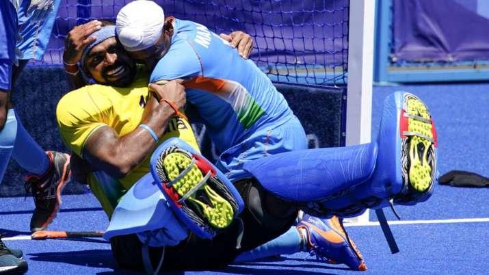 India goalkeeper Sreejesh Parattu Raveendran, left, celebrates with Mandeep Singh